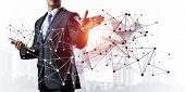 Businessman With Documents Pointing On Abstract Network With Polygonal Shapes. Standing Entrepreneur poster