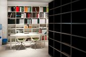 stock photo of book-shelf  - Office area with lot of books and table - JPG
