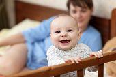 Happy Baby In Cot