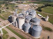 Industrial grain elevators and grain dryers in South Dakota, aerial view. poster