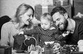 Couple In Love And Baby Girl. Valentines Day Concept. Together On Valentines Day. Lovely Family Cele poster