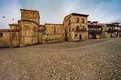Medieval Town In Santillana Del Mar Santillana Del Mar (cantabria - Spain). Romanesque Art Of The Tw poster