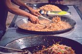 Asians Man Cooking Streetfood. Unidentified Asian People Sell Food At Night Market Walk Street. Asia poster