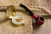 Compass And A Pipe With A Rope