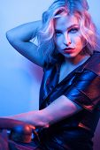 Attractive Woman Dressed In Fashion Apparel In Neon Night Lights. poster