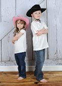 Sibling Cowboy And Cowgirl In Sweet Pose