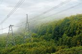 High Voltage Power Lines Tower In Mountains.  Energy Delivery Background. Efficient Electricity Deli poster
