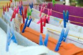 Colorfull Plastic Cloth Pegs On Hanging Clothes