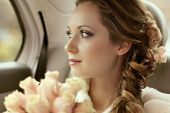 stock photo of single woman  - Beautiful bride woman portrait with bridal bouquet posing in her wedding day - JPG