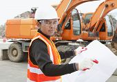 image of heavy equipment operator  - road construction worker and heavy equipment on the background - JPG