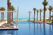 Huts At Swimming Pool Of The Luxury Hotel, Saadiyat Island, Abu Dhabi, Uae