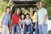 Extended Families Sitting In Tailgate Of Car