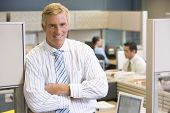 picture of portrait middle-aged man  - Portrait of business man in busy office - JPG