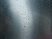 foto of rain-drop  - Rain drops on curved steel surface - JPG