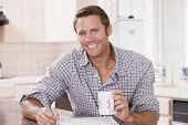 stock photo of portrait middle-aged man  - Man working from home using laptop - JPG