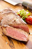 beef steak on the wooden plate