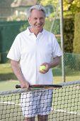 Man Playing Tennis And Smiling