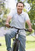 Man On Bike Outdoors Smiling