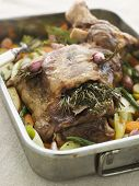 Slow Roasted Shoulder Of Lamb Stuffed With Herbs De Provence Roasted Vegetables