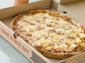 Ham And Pineapple Pizza In A Take Away Box