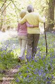 Couples Walking Outdoors With Walking Stick