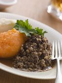 stock photo of haggis  - Tray of Jacket Potatoes Wrapped in Foil - JPG