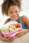 stock photo of school lunch  - Portrait of young girl with healthy packed lunch - JPG