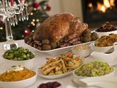 stock photo of christmas dinner  - Boxing Day Buffet Lunch Christmas Tree and Log Fire - JPG