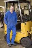 image of heavy equipment operator  - Warehouse worker in forklift - JPG