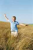 Young Boy Running Outdoors Smiling