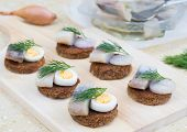 Small Canapes With Herring, Eggs And Shallot