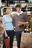 Young Couple Buying Wine