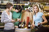 Three Women Buying Wine