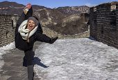 Woman Practicing Yoga on the Great Wall of China
