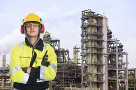 picture of retarded  - Young chemical engineer posing in front of a biodiesel refinary plant - JPG