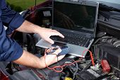 picture of internal combustion  - Auto mechanic working in garage - JPG