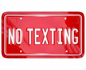 A red vanity license plate with the words No Texting to illustrate a warning about the dangers of text messaging while driving a car or other vehicle