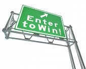 The words Enter to Win on a green freeway road sign to illustrate buying tickets for a lottery or betting in a casino or other place for games