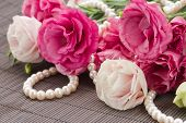 Pink eustoma flowers and pearls border