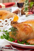 stock photo of horn plenty  - Garnished roasted turkey on fall festival decorated table with horn of plenty and red wine - JPG
