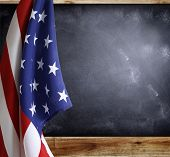 American flag in front of blackboard