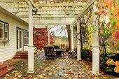 pic of barn house  - Northwest horse ranch white house with fall changing leaves and white fence - JPG