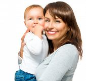 Mother and Baby kissing and hugging. Happy Smiling Family Portrait. Mom and Her Child Having Fun together. Isolated on a White Background