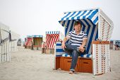 Young Happy Man On The Beach Of St.peter Ording, North Sea,