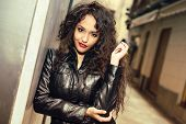 Attractive Black Woman In Urban Background Wearing Leather Jacket