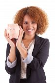 Young African American Business Woman Holding A Piggy Bank - African People
