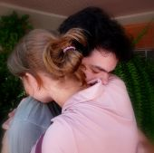 pic of forgiveness  - Young couple hugging. 