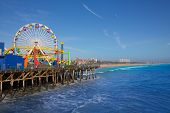 Santa Monica pier Ferris Wheel in California USA on blue Pacific Ocean