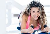 image of derriere  - Woman at the gym exercising on a machine - JPG