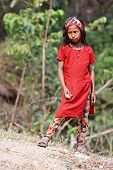 KALANKI, NEPAL - APRIL 2: Portrait of unidentified Nepalese girl in red dress on April 2, 2009 in Kalanki Village, Kathmandu, Central Region, Nepal.